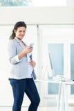 Confident pregnant businesswoman using phone Stock Images