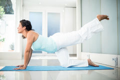 Confident pregnant woman performing yoga on mat Royalty Free Stock Photos