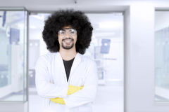 Confident professional scientist looking at camera. Portrait of confident professional scientist wearing protective glasses and lab coat while standing with Stock Photography