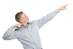 Successful businessman pointing fingers up suggesting achievemen Stock Photography