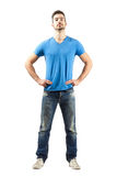Confident proud young male in akimbo pose. Full body length isolated over white background Royalty Free Stock Photos