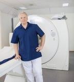Confident Radiologist Leaning On MRI Machine Royalty Free Stock Photo