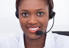 Confident receptionist using headset in hospital Stock Photos