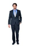 Confident relaxed business executive. In a stylish suit standing smiling at the camera with his hand in his pocket, full length isolated on white Royalty Free Stock Photos