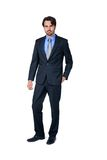 Confident relaxed business executive. In a stylish suit standing smiling at the camera with his hand in his pocket, full length isolated on white Stock Photo