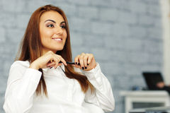Confident relaxed businesswoman in office environment Stock Photos