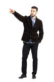 Confident relaxed man directional pointing at distance looking away Royalty Free Stock Image