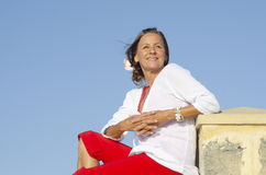 Confident relaxed mature woman isolated outdoor Royalty Free Stock Photography