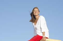 Confident relaxed mature woman outdoor Royalty Free Stock Image