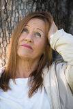 Confident relaxed mature woman Royalty Free Stock Photo
