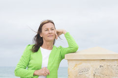 Confident relaxed middle aged woman Royalty Free Stock Photo