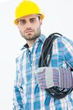 Confident repairman carrying pipe on shoulder Royalty Free Stock Image