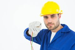 Confident repairman holding cables Royalty Free Stock Photos
