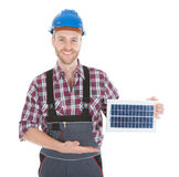Confident Repairman Holding Solar Panel Stock Image