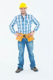 Confident repairman standing with hands on hips. Full length portrait of confident repairman standing with hands on hips against white background Stock Photo