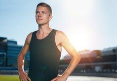 Confident runner on athletics racetrack Stock Photos
