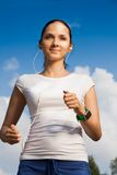 Confident runner with headphones Royalty Free Stock Photos