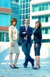 Confident Sales Team. A confident sales team poses for a picture in front of their office building Royalty Free Stock Photo