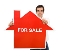 Confident salesman with house for sale sign royalty free stock photos