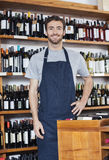 Confident Salesman Standing In Wine Shop Royalty Free Stock Photo