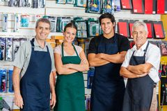 Confident Salespeople In Hardware Shop Royalty Free Stock Image