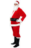 Confident Santa with a big belly posing sideways Royalty Free Stock Photo