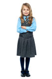 Confident school girl in pinafore uniform Stock Photos