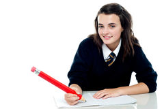 Confident school girl is ready to take up the test Royalty Free Stock Photo