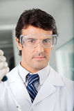 Confident Scientist In Protective Eyewear Royalty Free Stock Photos