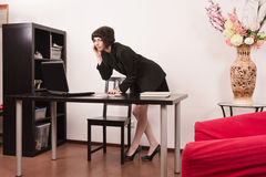 Confident secretary in a office Stock Images