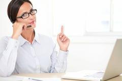 Confident secretary working on her desk Stock Photos