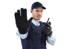 Confident security officer making stop gesture. Against white background Royalty Free Stock Image