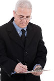 Confident senior business man writing on Stock Images