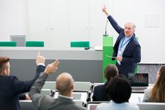Confident Senior Businessman Giving Presentation To Colleagues royalty free stock photography