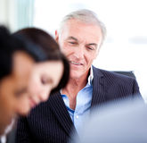 Confident senior businessman in a meeting stock photography