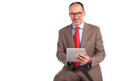 Confident senior businessman working on tablet Royalty Free Stock Images
