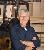 Confident Senior Carpenter With Arms Crossed Royalty Free Stock Photos