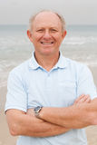 Confident senior citizen posing at beach Royalty Free Stock Image