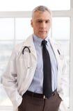 Confident senior doctor. Stock Photos