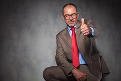 Confident senior entrepreneur showing thumbs up Stock Photo