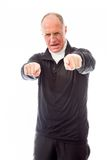 Confident senior man pointing towards camera with both hands Royalty Free Stock Images