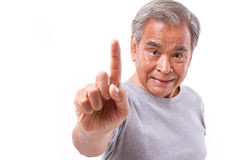 Confident senior man pointing up 1 finger, number 1 hand sign ge Royalty Free Stock Images