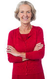 Confident senior smiling woman posing Stock Photography