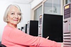 Confident Senior Woman In Computer Class Royalty Free Stock Photos