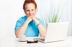 Confident senior woman with laptop Stock Photo