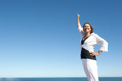Confident senior woman ocean background Stock Photos