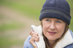 Confident senior woman warm winter bonnet Stock Photography
