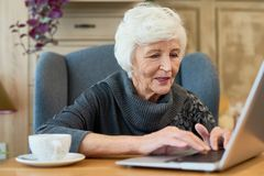 Senior Woman Using Laptop stock photography