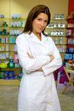Confident and serious female pharmacist stnading and smiling Stock Photos