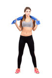 Confident serious young fitness beauty with towel Royalty Free Stock Image